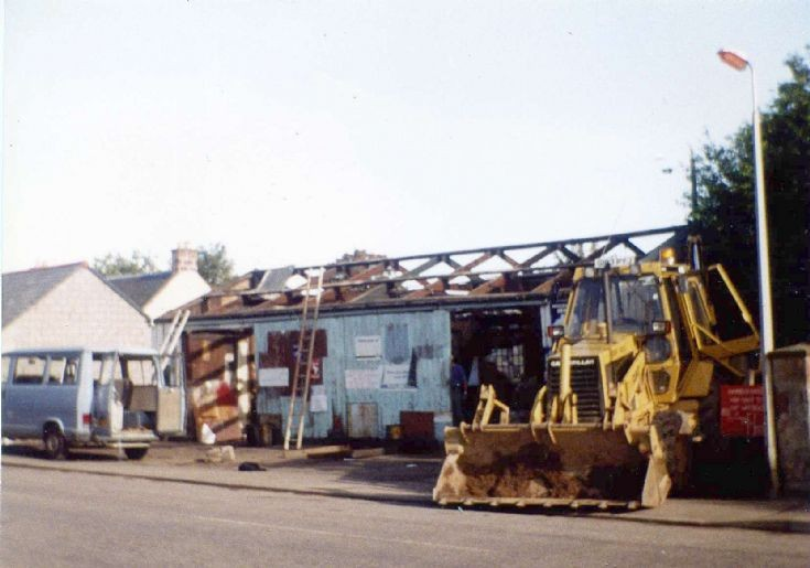 Demolishing the old Campbell's Garage.